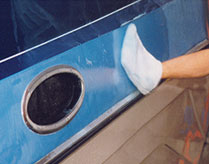 clean boat hull with sponge